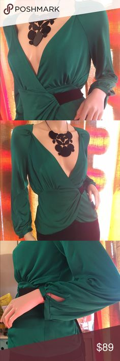 "DVF emerald green silk wrap top w black sash tie Elegant Diane Von Fursrenberg silk wrap top. Perfect emerald green hue for the upcoming holidays.  In excellent condition. Size P, 15"" underarm to underarm, 21"" shoulder to hem , waist varies as it's open and you tie closed Diane von Furstenberg Tops"
