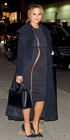 Chrissy Teigen wore a body-skimming dress with two vertical sheer cutouts down the front, accenting her growing bump to the max.