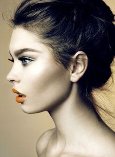 Beautiful soft makeup on fair skin  hair updo orange lips