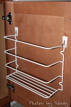 This is how I can hang this on my cabinets - command hooks.