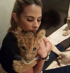 Lion Hugs from Maverick!   Go check out the great work @JaguarAndTiger is doing & donate! http://www.blackjaguarwhitetiger.org