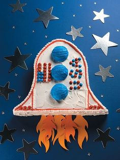 Space ship- Cut a rectangular cake to make the tip of the rocket and reattach the extra pieces to create wings. Use three cupcake tops as the blue circles and decorate it with red and blue M  from easy cut up cakes for kids