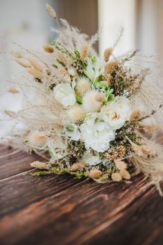 We loved the softness and textures of Sofia's all naturals, dried flower bride bouquet with pampas, white thistle, bunny grass and other dried flowers. By @gouriotiflowers #naturalweddingflowers #driedweddingflowers #driedweddingbouquet #pampasbouquet #naturalbridebouquet #bohobouquet #pampasgrasswedding #weddingflowersgreece #naturalweddingbouquet