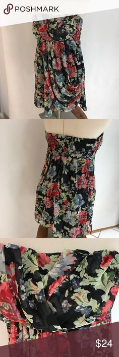 Draped Floral Strapless Dress Spring/Summer Draped Floral Dress. Perfect for outside parties. 27 ins long. Poly fully lined. Tag says L also fits M. Chesley Dresses Strapless