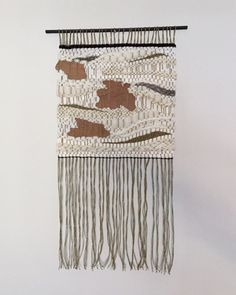 Handwoven wall hanging with cotton fibers, wool, natural fibers, and pieces of tree bark. Inspired by the landscape and flora of the Midwest. Dimensions: 15.5W x 25L Created in a smoke free environment.  Ready to Ship.