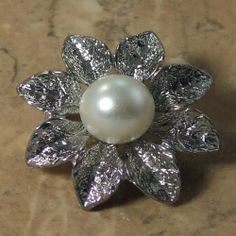 Classical pearl leaf brooch modern with a white simulated pearl Floral arrangement to this previously owned modern brooch in textured silver tone 1990s to 2000s