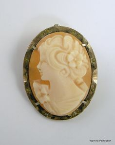 800 Silver Genuine Shell Cameo Brooch Use XMASJULY2012 for 20% off this item. $75.00, via Etsy.