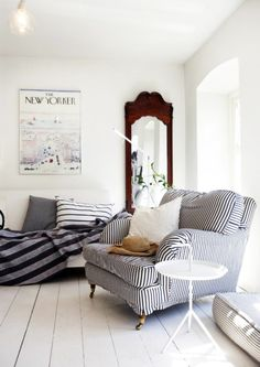 Stripes of various widths that run every which way, combined with a white-washed floor, give this living room spotted on Desde My Ventana a subtle coastal style. Simply adding a striped slipcover, throw pillows, or a blanket can make a room feel like a beach retreat. Nautical Rooms Done Right: Fresh Takes on Seaside Style | Apartment Therapy