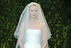A cathedral veil worn over a strapless silk Carolina Herrera gown was the epitome of timeless style at the Bridal Market Spring 2014 shows.