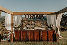 An equally elegant and fun outdoor reception bar   Image by Alexandria Monette Photography