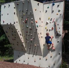 Make your own Rock Climbing wall! It has a whole extra playground off the back too. Such a cool idea for the backyard.