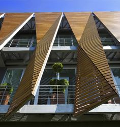 folded timber screen Office Building In Istanbul / Tago Architects