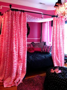 Love the walls - bright pink with the white chair rails. Maybe too much pink with the zebra fabric, though...better with b zebra print maybe?