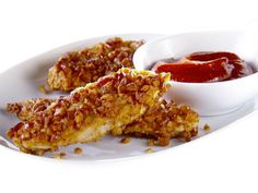 Pretzel-Crusted Chicken Fingers with Curry Ketchup recipe from Giada De Laurentiis via Food Network