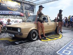 Girls posing with a beige Volkswagen Caddy Pickup #babe #babes #VW #Lady #Ladies #Model #Models #truck #pick-up #ute