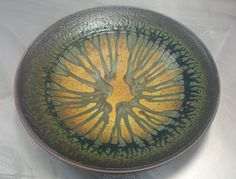 Image from http://www.wesleyanpotters.com/wp-content/uploads/2012/10/2012-ash-platter-nice.jpg.