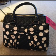 Betsey Johnson purse - new! Black Betsey Johnson purse with black and white polka dot bow on the front - has a quilted pattern - new with tags! Betsey Johnson Bags Satchels
