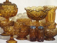 collection of vintage amber glass moon & star pattern glassware, bowls, vases etc.