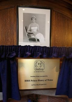 A plaque is unveiled underneath a picture of Princess Diana during Prince Harry's visit to Headway at Bradbury House during an official visit to Nottingham
