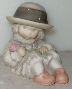 PRETTY AS A PICTURE FIGURINE Kim Anderson 175366 Girl Sitting Pink Flower 1995 - this is the first one I collected :o)