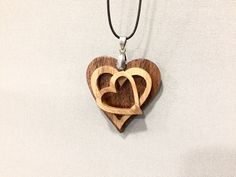 A beautiful triple HEART cut from solid Oak and Walnut wood, finished with gloss varnish Wooden Necklace, Heart Pendant Necklace, Wooden Rings, Wooden Jewelry, Wooden Crafts, Diy And Crafts, Laser Cutter Projects, Soap Carving, Heart Projects