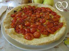 Focaccia con pomodorini http://www.cuocaperpassione.it/ricetta/ad1d1f4c-9f72-6375-b10c-ff0000780917/Focaccia_con_pomodorini