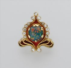 Art Nouveau Gold, Black Opal, Diamond and Enamel Ring   One oval opal ap. 1.50 cts., signed Marcus & Co., ap. 5.7 dwt.