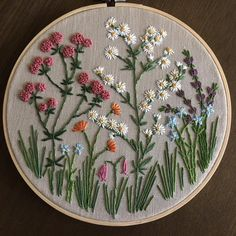 """Few new hoops added to my Etsy Shop. This one is a 8"""" meadow of wildflowers."""