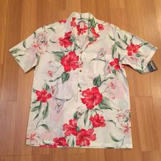 Vintage hibiscus aloha shirt Brand new vintage Hawaiian aloha shirt. Size large. Button front. One front pocket. Reddish pink hibiscus print. Paradise Found Hawaii Tops Button Down Shirts