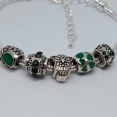 Our second charm bracelet up for grabs today includes a cute owl charm, with a selection of pretty green  beads with extra bling 😍 this beauty can be yours for just £10. #greenbracelet #owlbracelet #owljewellery #beads #silverplatedbeads #bling #beauty #greenismyfavoritecolor #supportsmallbusiness #pandora #pandorabracelet #pandorainspired #fashionjewellery #affordablejewellery #giftsforher #treatyourself Owl Bracelet, Bracelets, Owl Charms, Pretty Green, Cute Owl, Unicorn, Gifts For Her, Fashion Jewelry, Pandora