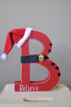 Would be cute with a B for believe, J for joy, C for Christmas, N for Noel, etc.or even just spell out Christmas with a holiday themed word on each letter and hats on the ends! Christmas Signs, Winter Christmas, All Things Christmas, Christmas Holidays, Christmas Decorations, Christmas Ornaments, Christmas Snowman, Merry Christmas, Christmas Projects
