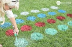 20+ DIY Yard Games that are perfect for summer entertaining, like this Giant Lawn Twister from One Good Thing by Jillee! These awesome lawn games for adults and kids - like cornhole, giant Jenga, Yardzee, tic tac toe + more - are perfect for backyards, camping trips, and family fun. Learn how to make DIY yard games from these easy tutorials, then enjoy these game all summer long! | Hello Little Home