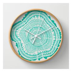 Turquoise Tree Rings Wall Clock ($30) found on Polyvore featuring home, home decor, clocks, wall clocks, turquoise home accessories, round wall clock, battery operated clock, abstract wall clock and kitty cat clock