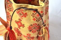 WAYUU BAG – Medium-Sized Mochila with Leather Cord. Handwoven by a woman from the Wayuu Tribe. Yellow/Orange/Brown. www.colombiart.co