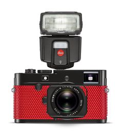 artist rolf sachs and camera brand leica have put their heads together to present the leica M-P grip: combining photographic capability with artistic flair.
