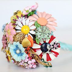 """Brides Magazine: Wedding Wonderland.  Party aesthetic is described as """"offbeat"""" you can skip having a specific color scheme and go wild.  Earn extra wacky points with bouqet made out of vintage brooches"""