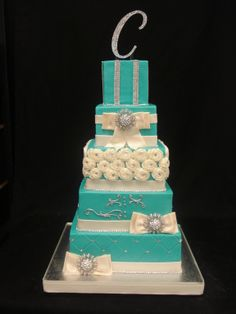 Tiffany blue wedding cake with white ribbon and rosette details and crystal accents
