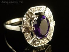 Amethyst & Diamond 18ct white gold ring is outstanding. Set with a 1.90ct centre rich purple amethyst surrounded by smaller DiamondsThe Diamonds are a mixture of round brilliant and baguette cut Diamonds from the 1920's