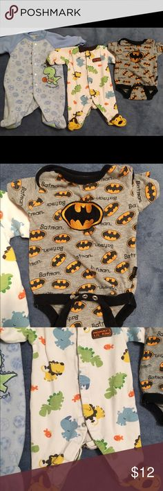 Adorable newborn boy bundle Used but in great condition! Comes with two footies and a batman top. If you only want specific items, let me know and I can reduce the price. Or I can substitute another onesie in its place, just see my other ads. One Pieces Footies