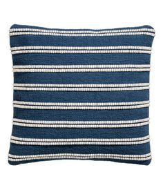 Dark blue/striped. Cushion cover in cotton with a jacquard-weave front and solid-color canvas back. Concealed zip.