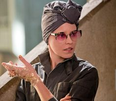 See? Effie can perk up a drab D13 outfit. And you guys were worried about her. Pfft. Still from The Hunger Games: Mockingjay Part 1 via Elle Magazine.