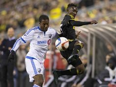 ov. 8, 2015; Columbus, OH, USA; Columbus Crew SC defender Harrison Afful, right, tries to keep the ball in play over Montreal Impact midfielder Patrice Bernier in the first half in Columbus, Ohio.  Trevor Ruszkowski, USA TODAY Sports