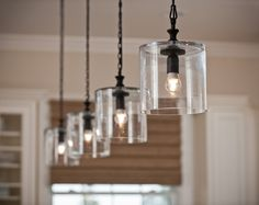 Attach pendants to a long board and suspend from ceiling with only one cord coming down for a rental home overhead lighting