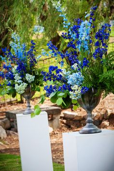 Tall blue and green Wedding aisle flower décor, wedding ceremony flowers, pew flowers, wedding flowers, add pic source on comment and we will update it. www.myfloweraffair.com can create this beautiful wedding flower look.