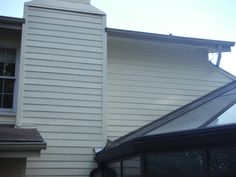 Melted siding replaced with HardiePlank Woodland Cream