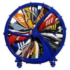 Stow up to 15 pairs of children's shoes in this vibrant storage wheel, showcasing a castered design and blue finish.   Product: