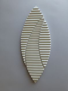 """Winds of Change"" wall mounted ceramic sculpture."