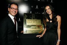 Demi Moore presented the award to Pierre Rainero, Cartier International's image, style, and heritage director.
