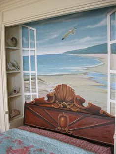 Mural for a wall behind a Murphy bed. Trompe l'oeil sea shells and shelf painted to fill in the sides. The top of the headboard is a mural and the actual rectangle piece ( that is the headboard ) is Faux wood.