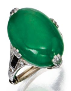 Platinum, Jadeite, Diamond and Onyx Ring, Circa 1925. Set in the centre with an…